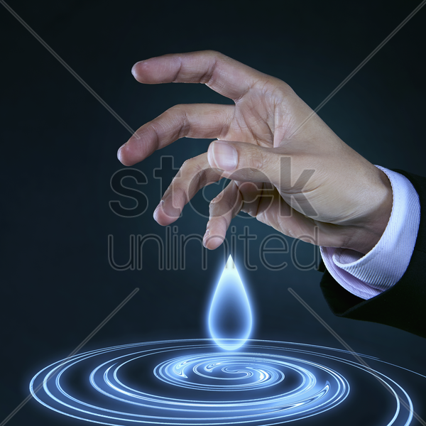 drop of water with ripple effect stock photo