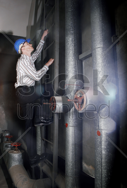 engineer climbing up the stairs stock photo