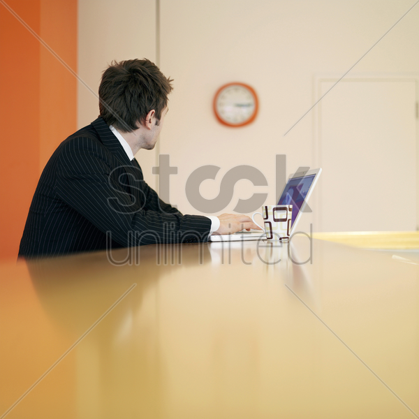 executive using laptop stock photo