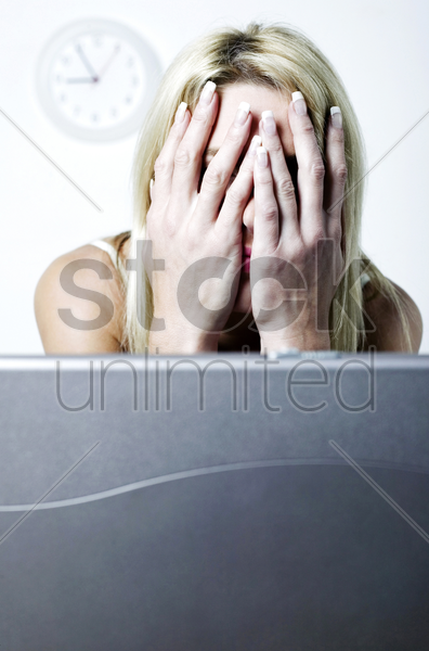 exhausted woman taking a break from her work stock photo
