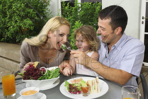 family having a meal at an outdoor restaurant stock photo