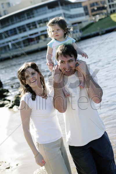 family having fun on the beach stock photo