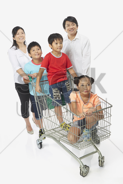 family of five shopping together stock photo
