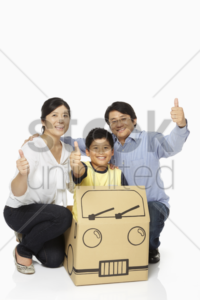 family of three showing hand gesture stock photo