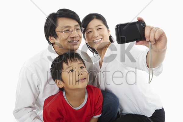 family taking a photo together stock photo