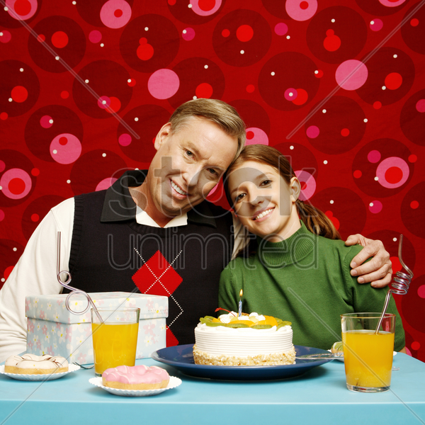 father and daughter celebrating birthday stock photo
