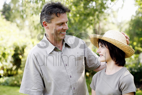 father and daughter in the park stock photo