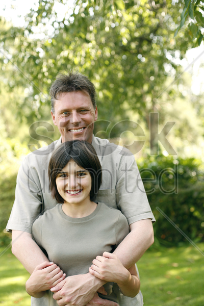 father and daughter posing for the camera stock photo