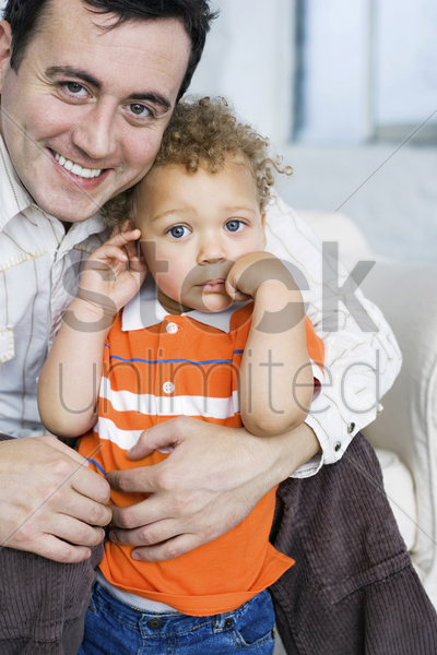 father and son posing for the camera stock photo