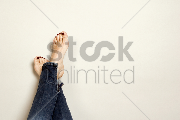 feet with beautifully painted toenails stock photo