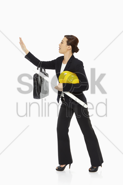 female architect showing hand gesture stock photo