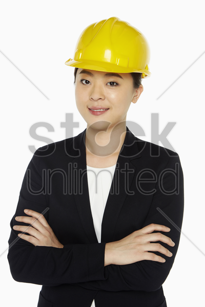 female architect standing with arms crossed stock photo