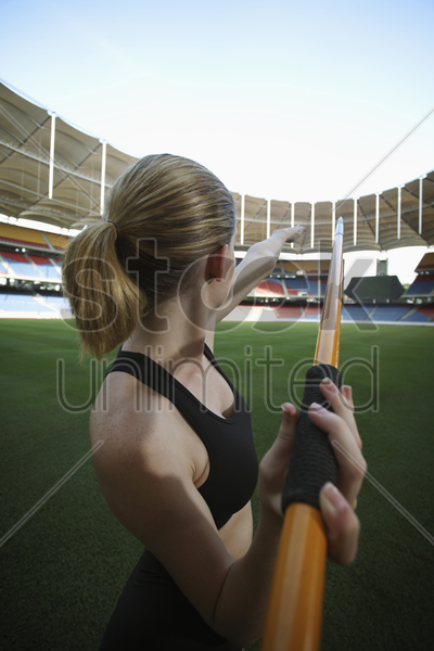 female athlete throwing a javelin stock photo