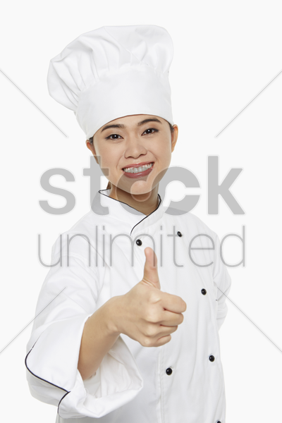 female chef giving thumbs up stock photo