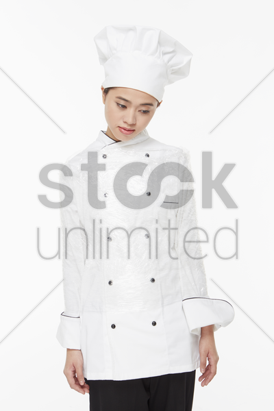 female chef tied up with a cling wrap stock photo
