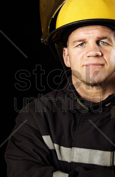 fireman in full uniform and safety helmet stock photo