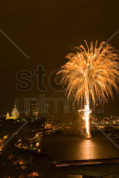 fireworks over river thames stock photo