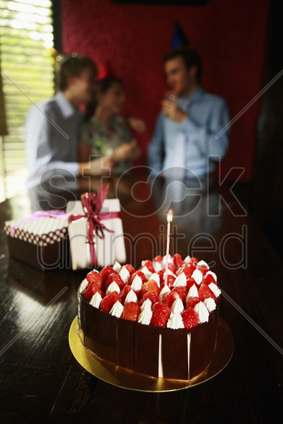focus on birthday cake and gifts of a birthday celebration stock photo