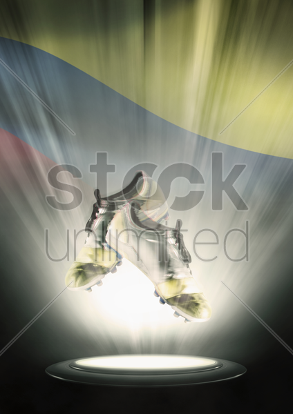 football cleats with colombia flag backdrop stock photo
