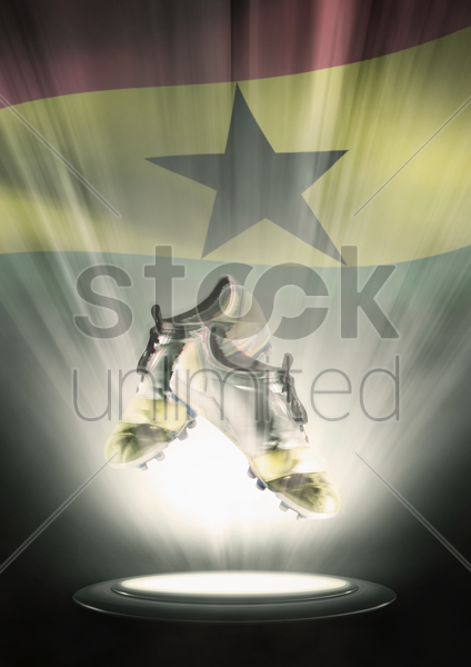 football cleats with ghana flag backdrop stock photo