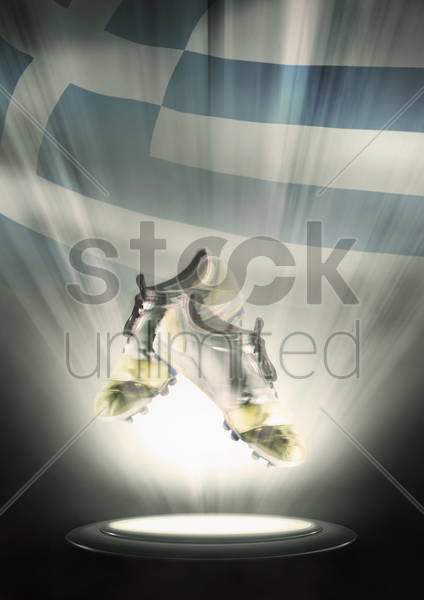 football cleats with greece flag backdrop stock photo