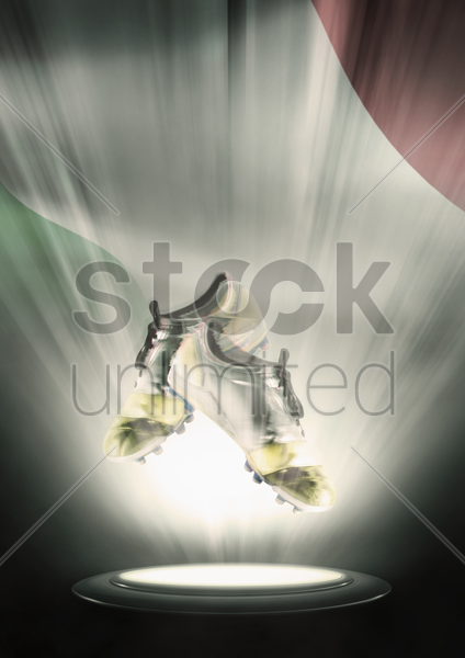 football cleats with italy flag backdrop stock photo