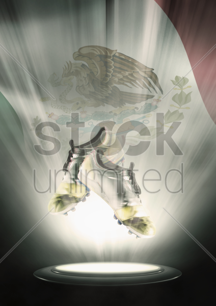 football cleats with mexico flag backdrop stock photo