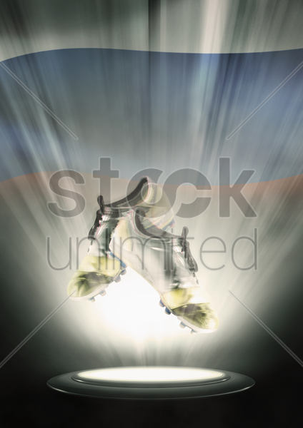 football cleats with russia flag backdrop stock photo