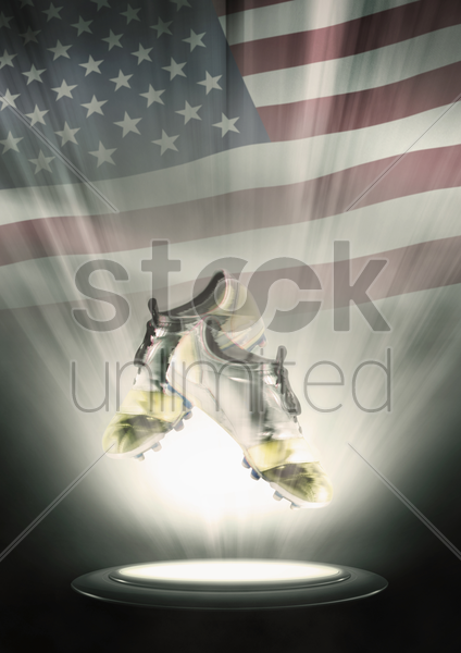 football cleats with united states of america flag backdrop stock photo