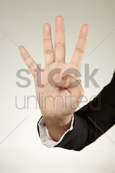 four fingers held up stock photo