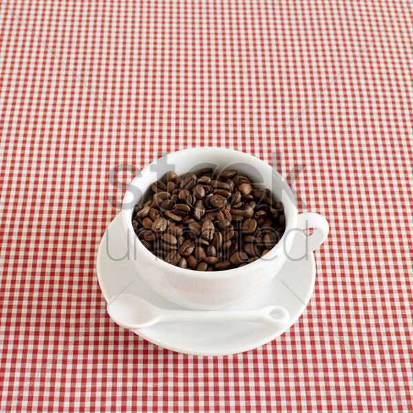 fresh espresso coffee beans in a cappuccino cup stock photo