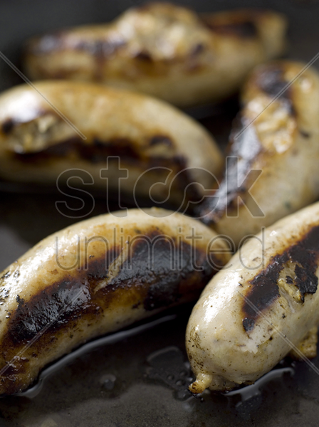 fried sausages stock photo