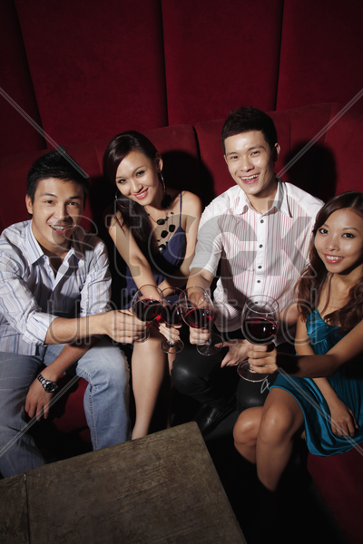 friends toasting wine stock photo