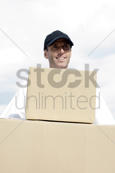 front view of a delivery man on duty stock photo