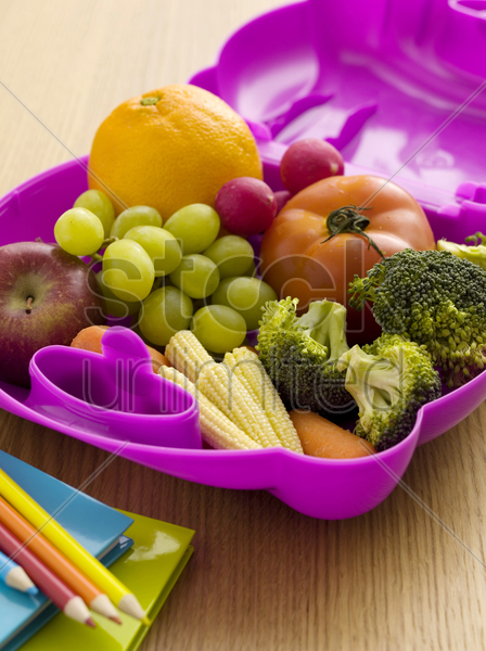 fruits and vegetables in a lunch box stock photo