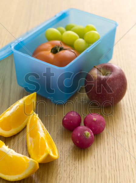 fruits in a lunch box stock photo