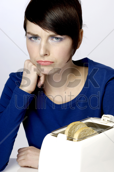 frustrated woman waiting for her toast stock photo