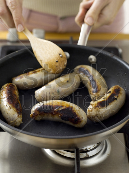 frying sausages stock photo
