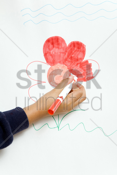 girl colouring picture on drawing board stock photo