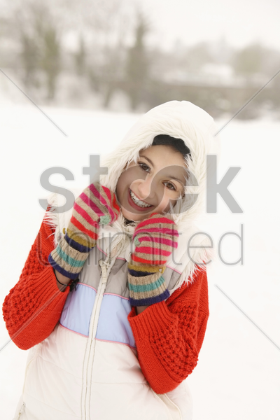 girl covering her head with hoodie stock photo