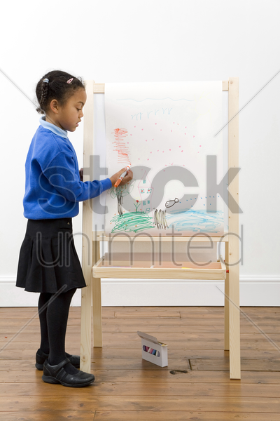 girl drawing on drawing board stock photo