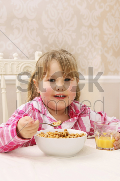 girl having healthy breakfast stock photo