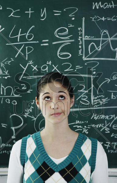 girl having problems solving the confusing equation stock photo