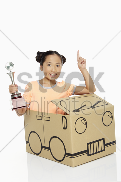 girl holding a trophy stock photo