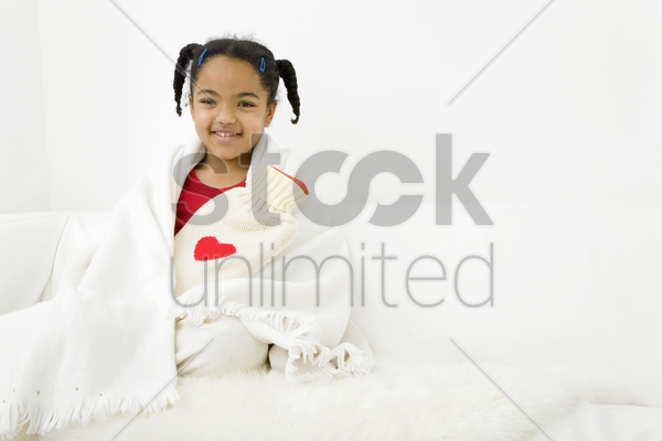 girl hugging a hot water bottle stock photo