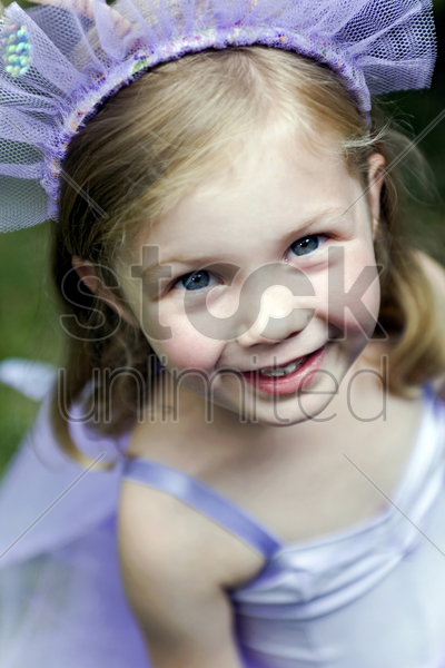 girl in ballet costume smiling at the camera stock photo