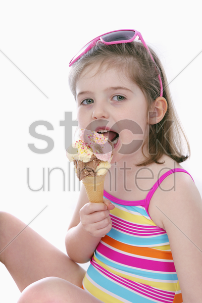girl in swimwear eating ice-cream stock photo