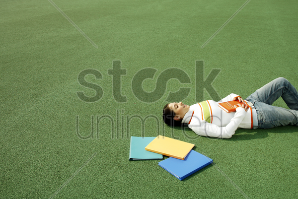 girl lying on the field stock photo