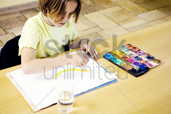 girl painting with brush stock photo