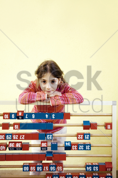 girl posing with a large abacus stock photo
